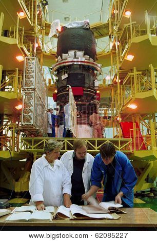 BAIKONUR COSMODROME - OCTOBER 29 2000:  Russian space technicians and engineers test the solar array on a Progress M1 spacecraft in the RSC Energia vehicle assembly building on OCTOBER 29 2000 in Baikonur, Kazakhstan