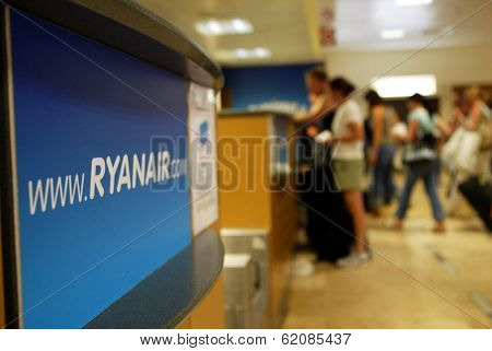GERONA - October 21: Passengers line up at a check-in desk for Ryanair, the low budget carrier at Gerona, Spain, on October 21, 2005.