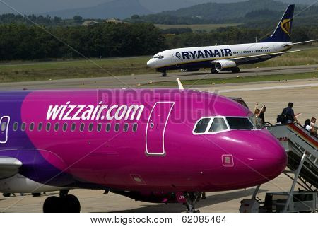 GERONA - SEPT. 6:  East European budget airline WizzAir on the tarmac at Gerona, Spain, on September 6, 2004. A Ryanair plane is at rear.