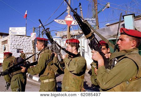 HEBRON - DECEMBER 15: Soldiers of the Israeli army's 101st Airborne Division Apache Platoon patrol the streets of Hebron on December 15, 1999.