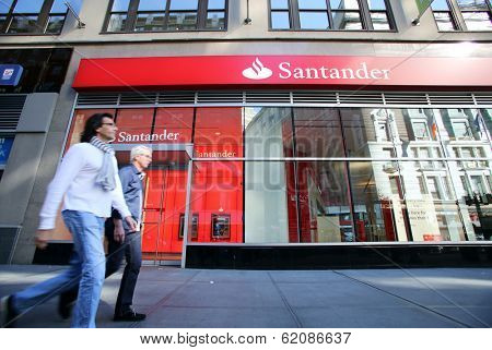 NEW YORK CITY - OCT 20 2013: Pedestrians walk past a branch of Santander Bank in Manhattan on Sunday, October 20, 2013.