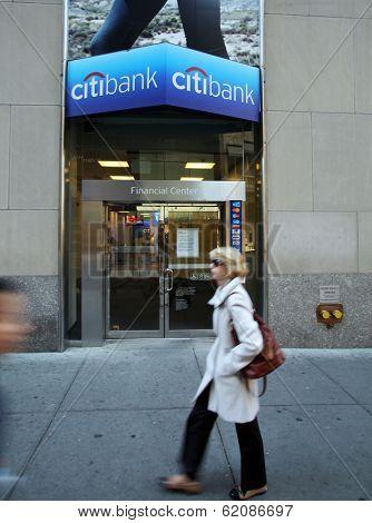 NEW YORK CITY - OCT 20 2013: Pedetrians walk past a Citibank SA retail bank branch in Manhattan on Sunday, October 20, 2013.