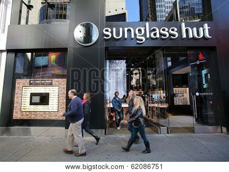 NEW YORK CITY - OCT 23 2013: Pedestrians walk past a HSBC bank branch in Manhattan on Wednesday, October 23, 2013. HSBC Holdings plc is a British multinational banking and financial services company