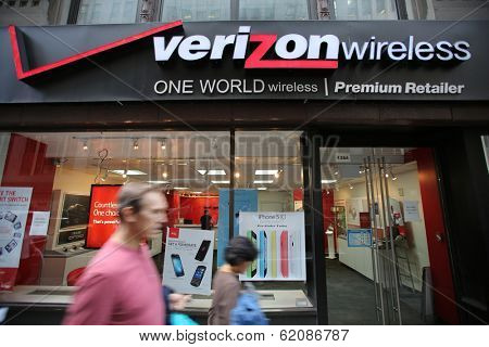 NEW YORK CITY - OCT 17:  Pedestrians walk past a Verizon Wireless retail outlet in Manhattan on Thursday, October 17, 2013.