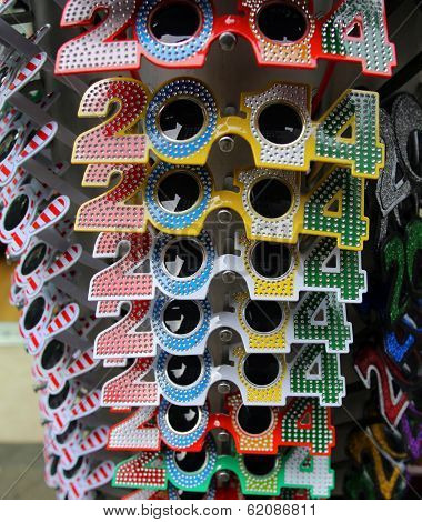 NEW YORK CITY - DECEMBER 28, 2013: Novelty glasses celebrating New Year's Eve 2014 on display at a shop in Times Square.