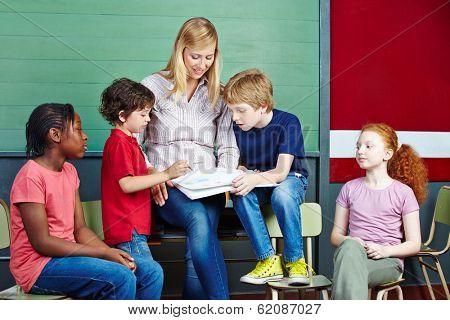 Students and teacher learning together in elementary school class