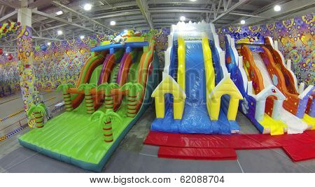 MOSCOW, RUSSIA - DEC 21, 2013: (aerial view) Inflatable slides in Crocus city hall before New Year.