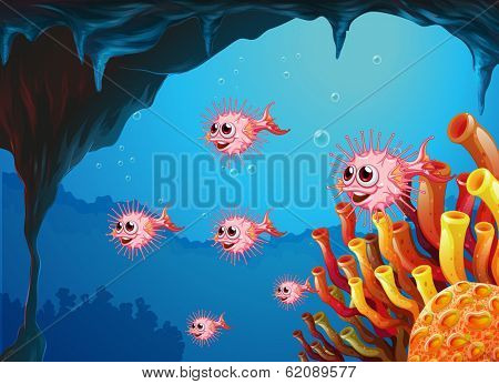 Illustration of the puffer fishes inside the sea cave