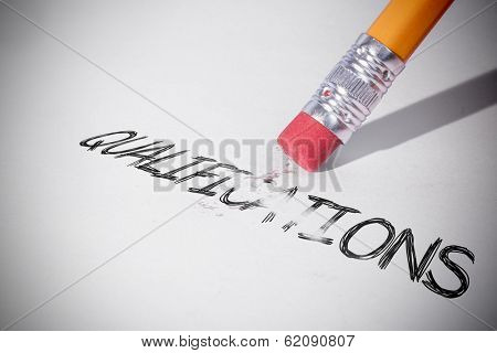 Pencil erasing the word qualifications on paper