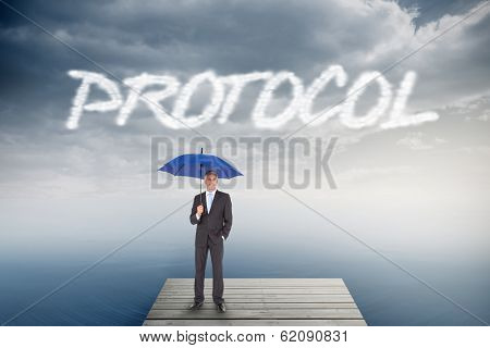 The word protocol and businessman smiling at camera and holding blue umbrella against cloudy sky over ocean