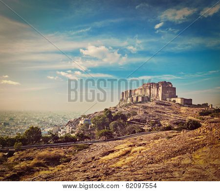 Vintage retro hipster style travel image of Mehrangarh Fort, Jodhpur, Rajasthan, India