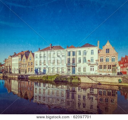 Vintage retro hipster style travel image of canal and medieval houses. Bruges (Brugge), Belgium with grunge texture overlaid