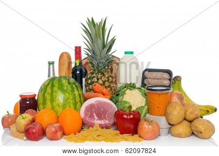 Groceries studio shot of fresh food and drink isolated on a white background, including fruit, vegetables, meat, sauces, pizza, wine and dairy products.