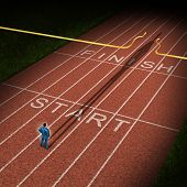 image of acceleration  - Forward thinking business concept for success acceleration with a businessman standing on the start line in a track and feild path with a cast shadow breaking through the finish line ribbon for victory - JPG