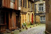 Medieval street with half-timbered houses in Rennes, France.