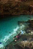 stock photo of cenote  - Sub are preparing for diving in a cenote Mexico - JPG