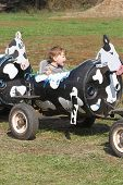 foto of hayride  - Child having fun on a farm ride - JPG