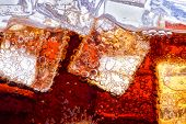 stock photo of coca-cola  - Background of cola with ice and bubbles - JPG
