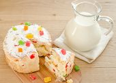foto of pitcher  - Homemade panettone with a pitcher of milk