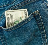 pic of twenty dollars  - A twenty dollar bill sticking out the back pocket of denim blue jeans - JPG