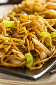 foto of lo mein  - Asian Chow Mein Noodles with Vegetables and Chopsticks - JPG
