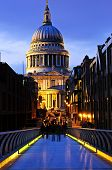 View of St. Paul's Cathedral in London from Millennium Bridge at night
