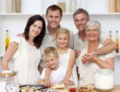 picture of grandparent child  - Grandparents parents and children baking in the kitchen - JPG