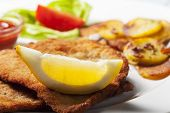 foto of wieners  - closeup of a wiener schnitzel with roasted potatoes - JPG