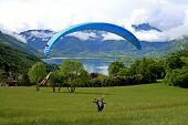 image of annecy  - paraglider on a beginner slope by Lake Annecy - JPG