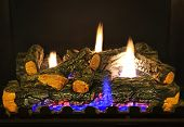 pic of cozy hearth  - Close up of logs in gas fireplace - JPG