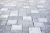 stock photo of interlock  - Gray interlocking paving stone driveway from above - JPG