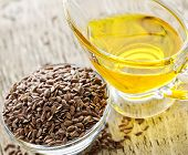 picture of flaxseeds  - Bowl of brown flax seed and linseed oil - JPG