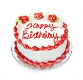 foto of uncut  - Birthday cake with white and red icing isolated on white - JPG