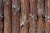 image of log fence  - close up of wooden fence made of logs - JPG