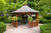 Gazebo in landscaped garden with interlocking stone patio