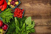 stock photo of farmer  - Fresh farmers market fruit and vegetable from above with copy space on brown wood - JPG