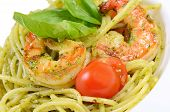 stock photo of pesto sauce  - Spaghetti with sauce pesto and shrimps macro - JPG