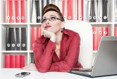 picture of boring  - Boring business woman in glasses working at office - JPG