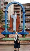 BEIRUT - MARCH 25:  A large portrait of the Ayatolla Khomeini watches over passersby in Herat,  a  p