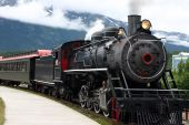image of loco  - steam engine train leaving the station full of tourists - JPG