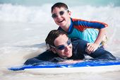 image of boogie board  - Father and son surfing on boogie boards - JPG