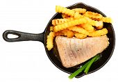 Oven Baked Sashimi Tuna with Fries and Green Onion in Cast Iron Skillet Over White.