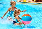 stock photo of pool ball  - Little girl  playing ball in swimming pool - JPG