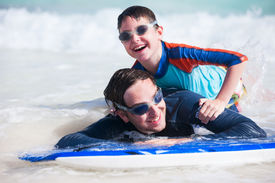 pic of boogie board  - Father and son surfing on boogie boards - JPG
