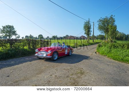 Oldtimer racing through the countryside
