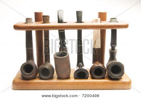 Pipe Collection In Wood Pipe Rack