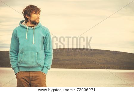Young Man Hipster Standing Alone Outdoor With Mountains And Lake On Background Lifestyle And Melanch