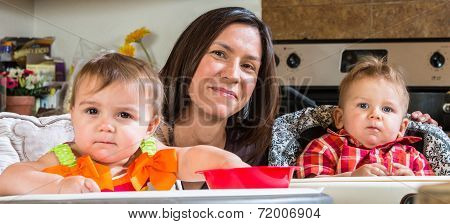 Mother Smiles With Babies