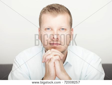 Young Blue Eyed Man Looking Directly Into The Lens