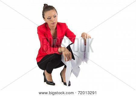 Businesswoman looking in sheets